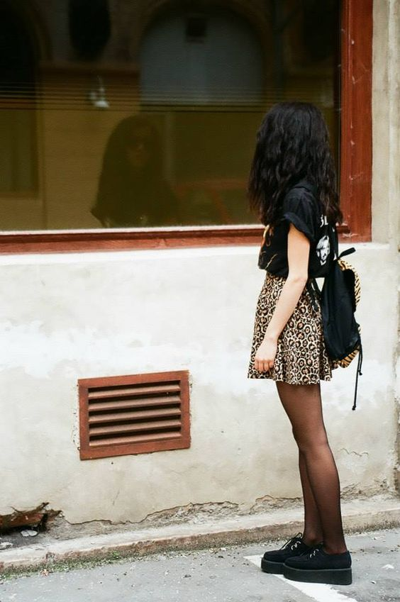 black creepers, black tights, leopard print skirt, black shirt, black backpack