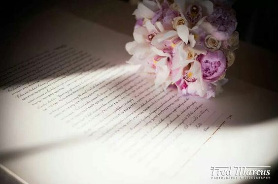 Such a nice photo idea...flowers with wedding contract or vowels...