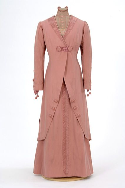 Pink cloth suit trimmed with pink ribbon and lace. Made by dressmaker Julia Tomasek, St. Paul, Minnesota.
