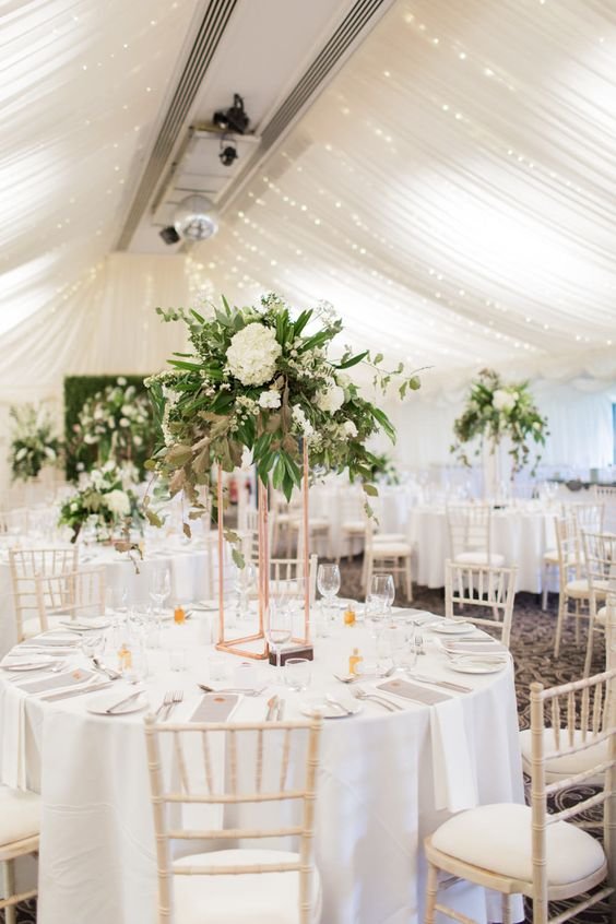 Tall Floral Centrepieces | Greenery & White Marquee Wedding at The Villa, Levens with Copper Details | Bowtie and Belle Photography