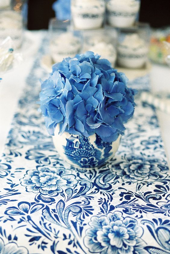 blue & white table runner and vase with blue hydrangea head - Image by Samantha Ward Photography - A chinese influenced wedding in York with a blue and white colour scheme , hydrangea and garden games: