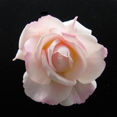 pink rose hair flower from www.serendipitytiaras.com