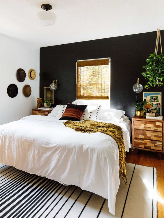 A Boho And Rustic Space With A Black Headboard Wall Is Balanced With Warm Colored Wood And A Window In Thi Black Walls Bedroom Accent Wall Bedroom Bedroom Wall