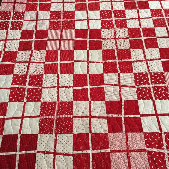alatimer's photo: I love red and white. My bedroom when I was little was red and white. Wallpaper was red/white stripe carpet was red. I thought about it the whole time this quilt was on. Tried a new wavy crosshatch pattern. Such a fun quilt @sewcheap #latimerlanequilting #longarmquilting