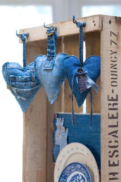 DIY denim hearts from your old jeans - cut heart shapes size desired, hand or machine stitch, leaving small opening; stuff with filler, complete stitching; add belt loops for hangers.: