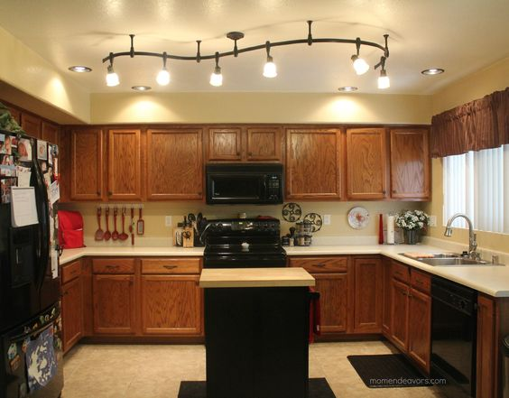 Custom-shaped monorail track lighting for real life family kitchen.