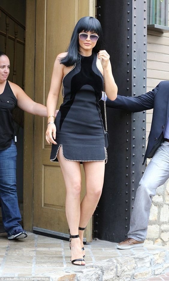 Dark horse: Kylie Jenner was decked out in designer items from head-to-toe for a lunch to celebrate Caitlyn's birthday in Woodland Hills, California, on Tuesday