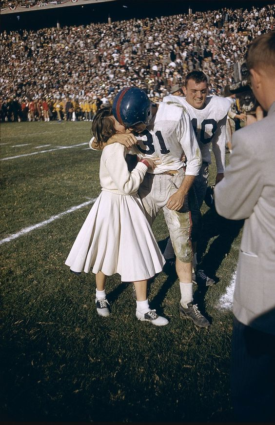 A victorious University of Mississippi player being kissed by a cheerleader after the Cotton Bowl (1956)