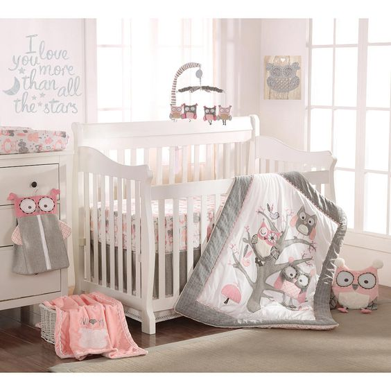 "Babies R Us Exclusive! The Night Owl Pink Nursery Collection features a detailed family of owls embroidered and appliqued in gray herringbone and soft fluffy textures. Grey, pink and ivory make up the color-way combined with cotton twill, jersey and eclectic patterns. The 5 Piece Crib Bedding Set includes a Quilt, 100% Cotton Crib Fitted Sheet, Dust Ruffle, Diaper Stacker and metallic silver Wall Decals with the phrase ""I love you more than all the stars."""