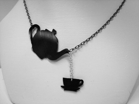 """""""Tea Time Silhouette Recycled Vinyl Necklace by RandomPrefect""""    Made out of a use record, this awesome looking necklace reminds me of many different things I enjoy - Alice in Wonderland, My Grandmother, Tea itself, The Birthday Massacre, Gothic Revival, Silhouette Art... Yes. It is an awesome necklace, and I bloody-well want it."""