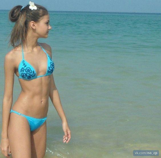 Teen In Blue Bikini