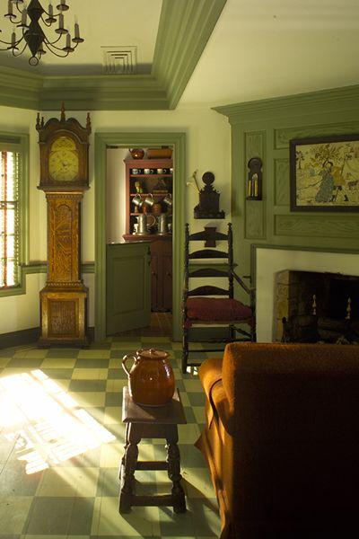 Farmhouse living room love the green trim antique for Primitive interior designs