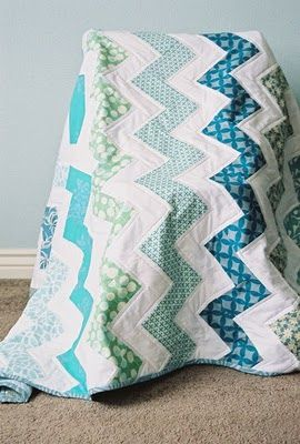 zigzag or chevron quilt. Love this! I think it would be beautiful as a crib quilt as well, and maybe rag as well. The accompanying tutorial looks a little bit more complicated than necessary but looks excellent & easy to simplify.