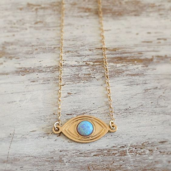 "Gold filled necklace with evil eye pendant and blue/ white opal stone inlay. Evil eye necklace for protection and luck! Necklace Measures Approximately 17""- as default ***Please select a size from the"