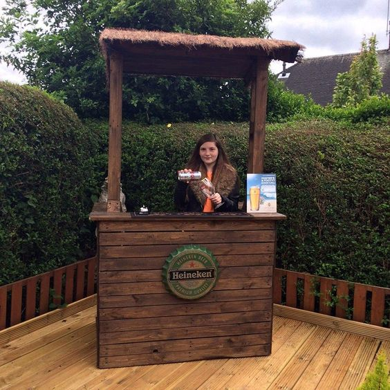 Pallet Bar with Shelter and Big Bottle Cap Logo - --- 15 Cool Projects Made from Pallets | 101 Pallet Ideas