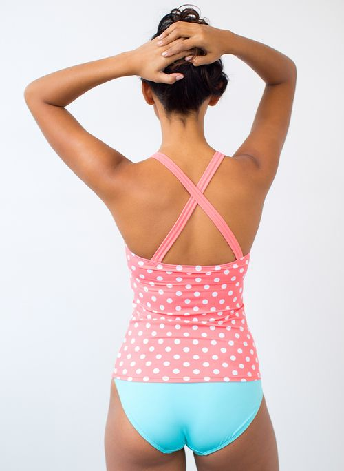 Get an effortless look in our Cinch-Neck Sorbet Dot Tankini swim top. This cute pink polka dot suit will make you feel confident and comfortable! Available in standard and plus-size fits.
