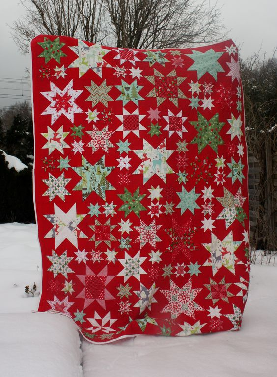 Christmas Quilt by Alex Eckert at Ideen Boutique at Flickr.  From the Oh My Stars quilt along.  For the quilt along see http://thoughtandfound.wordpress.com/2011/12/02/oms3/: