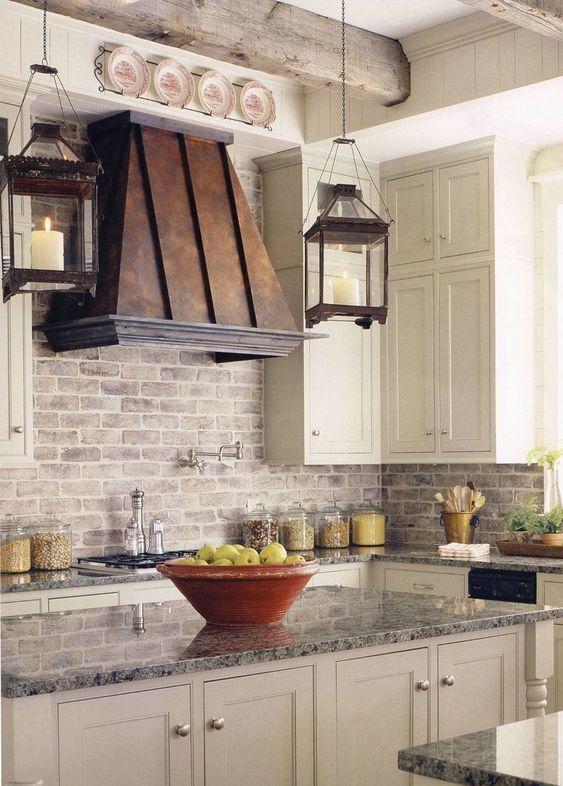 copper range hood tuscan kitchen french country kitchen brick backsplash