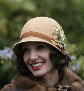 Angelina Jolie in beige felt cloche for the movie, The Changeling. (Photo via Diamond Dame).