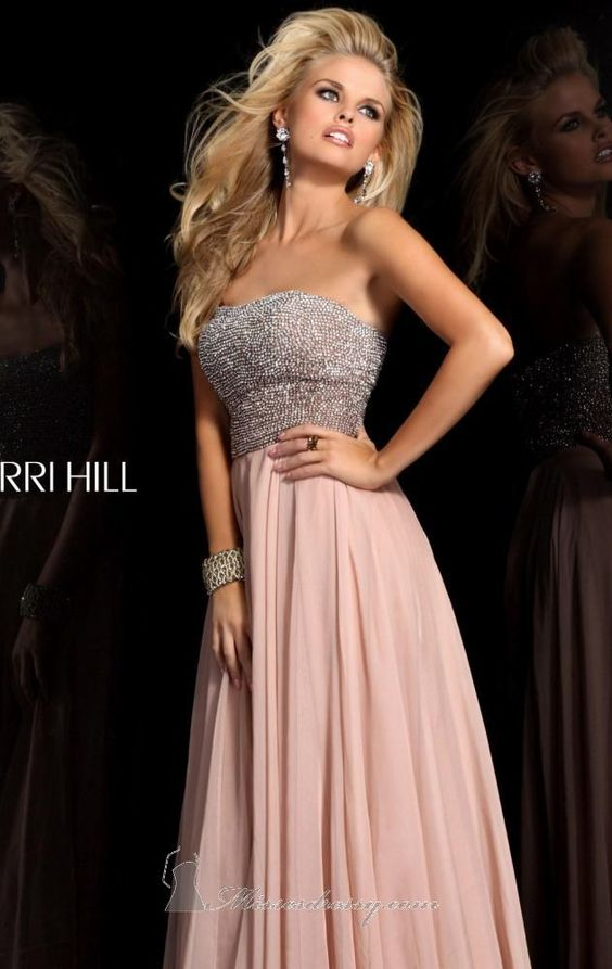 Make a lasting impression in this sophisticated creation of Sherri Hill 11017. This dress features a strapless design, soft sweetheart cut neckline and low-back style. The fitted bodice is covered with intricate beads that creates a flattering fit. A romantic flowing skirt finishes this elegant dress. When measured from waist to hem, this dress has a length of 45 inches long. Note: Dry clean only.