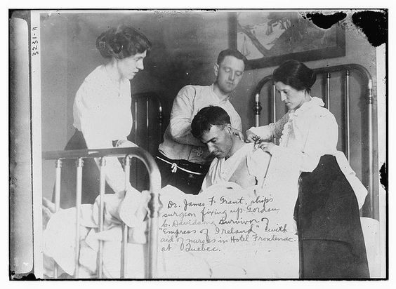 Dr. James F. Grant, ships surgeon, fixing up Gordan C. Davidson, survivor of EMPRESS OF IRELAND, with aid of nurses in Hotel Frontenac at Quebec (LOC) by The Library of Congress, via Flickr