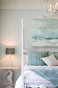 The seahorse table is definitely a fun touch, along with the beautiful painting and the wood bed. You get a beach feel without having to use a lot of specific decorative items.