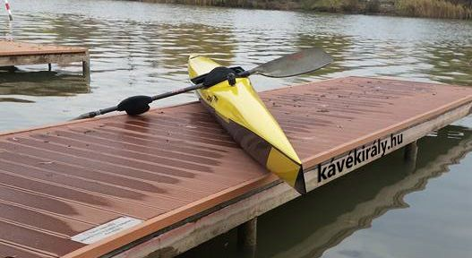 K1 kayak boat for competition parked on pier, River Danube, Csepel, Hungary