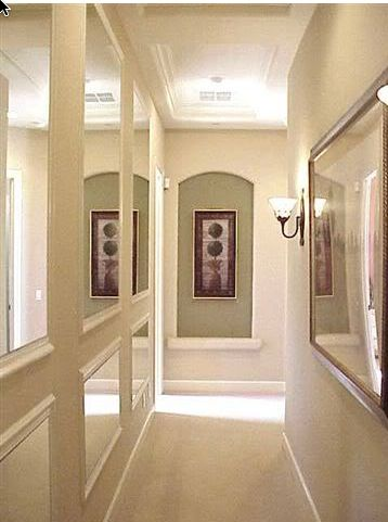mirrors down long hallway