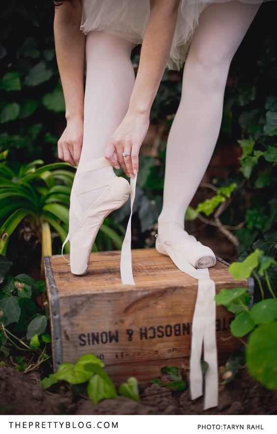 Ballerina fastening her points | Photography: Taryn Rahl