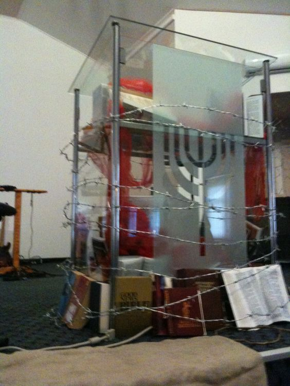 This church wrapped their pulpit in barbed wire to show they were One With Them.   (Our persecuted brothers and sisters in Christ)