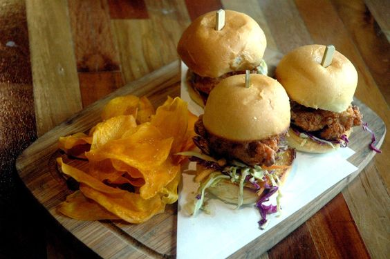 Tori Karaage Sliders, with Japanese style brined chicken topped with slaw on soft brioche