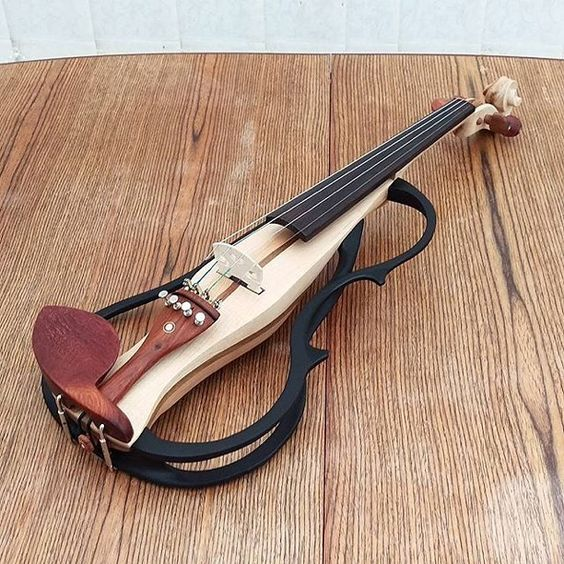 This electric violin is incredible! I can't imagine how long it took to make. @davidc_designer is a true craftsman. #violin #music #craftsman #handmade #electricviolin by moderngearforlife