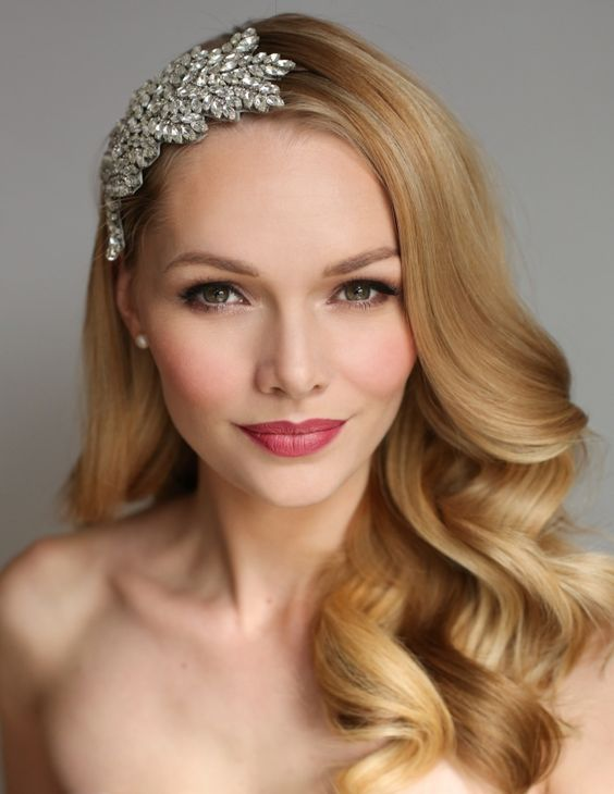 Timeless wedding makeup. Softly matt skin with a raspberry lip works perfectly with a Hollywood red carpet inspired hairstyle.