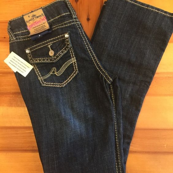 Almost Famous Boot Cut Jeans Almost Famous boot cut jeans, embellished pockets, size 9. Almost Famous Jeans Boot Cut