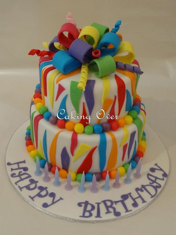 Two tier rainbow themed cake bottom tier was chocolate mud and top tier red velvet