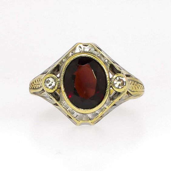 Edwardian 1.41ct t.w. Garnet & Old Mine Cut Diamond Filigree Ring 14k | - SOLD: 1-15-15 Antique & Estate Jewelry | Jewelry Finds Price: $799.00  Look what I found! Here is a lovely Edwardian era natural rich deep red garnet and old mine cut diamond ring made entirely in 14k solid two tone gold. What a great piece from the early 1920's! The central oval garnet weighs an approximate 1.25cts and is adorned by two .08ct old mine cut diamonds -