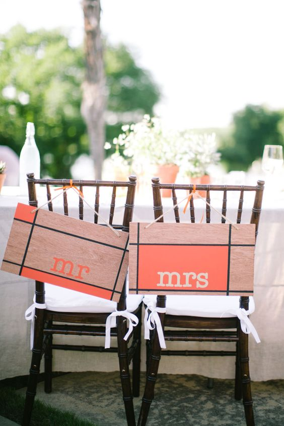 """Adorable rustic orange and wood """"Mr."""" and """"Mrs."""" chair signs.  Photo by Jess Barfield Photography. www.wedsociety.com  #wedding #chairs"""