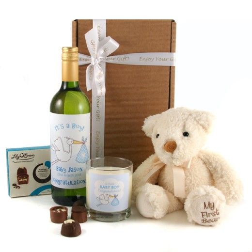 """A Beautiful New Baby Gift Set... for both the new baby boy and the new proud parents. Included is baby's first teddy bear he's super soft and cuddly with the softest cutest brown nose. For the new parents we've designed and printed labelling for the wine bottle. You can personalise the wine label with the baby boy's name and his birth date. The wording """"It's a Boy"""" is fixed so can't be changed."""