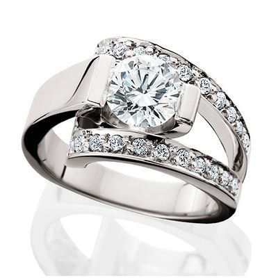 14kt white gold with .50tw of diamonds. Center for 6.5mm (1ct diamond)