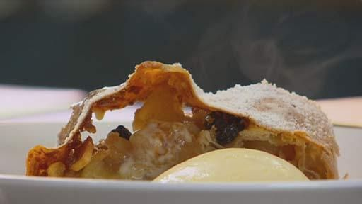 Ingredients    Strudel pastry  225g plain flour, plus extra for kneading  1 whole egg  125ml warm milk  ½ teaspoon salt  30g butter, melted  Apple filling  5 pink lady apples  60ml brandy  1 teaspoon ground cinnamon  ¼ cup raisins  ¼ cup flaked almonds  Zest of 1 lemon  ¾ cup (165g) brown sugar  125g fresh sourdough breadcrumbs  60g butter, melted for brushing  Icing sugar, for dusting  Double cream, to serve