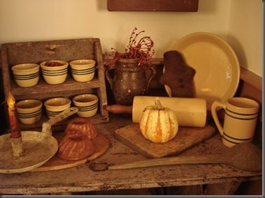 love the wooden shelf of small pottery bowls