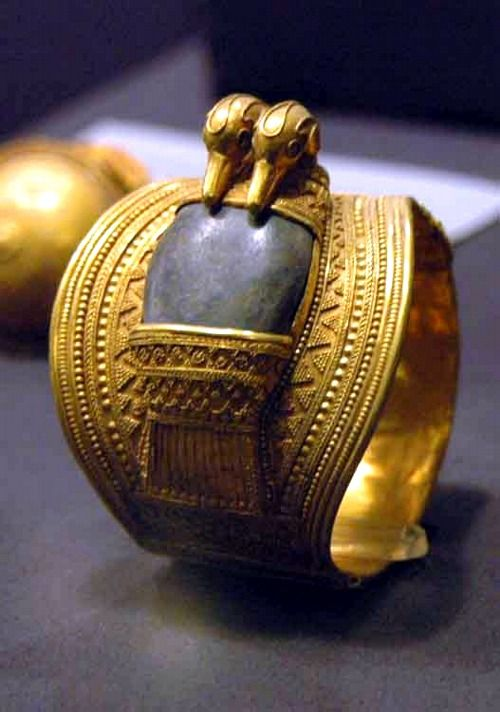Solid gold bracelets set with lapis lazuli and bearing the cartouches of Ramesses II