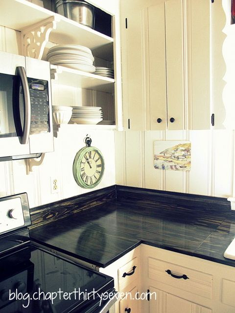 Gorgeous DIY countertops!  Just plain pine boards, 24 inches wide, from the hardware store, black stain and six coats of floor-grade sealer.