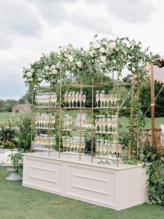 Elegant garden wedding venue with champagne bar and green decor
