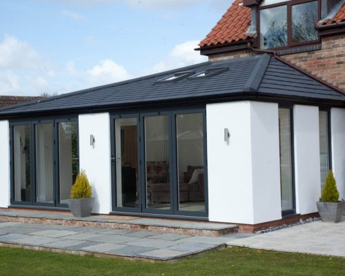 Sunrooms Solid Roof Sunrooms In Hampshire Wessex Windows House Extension Design House Roof Roof Styles