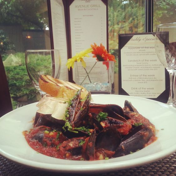 Mussels in Red Wine & Roasted Garlic Tomato Sauce - $5