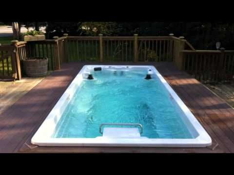 Endless Pools® Swim Spas 2013 Model - YouTube with a spa in my gym/sunroom off the back of the house.