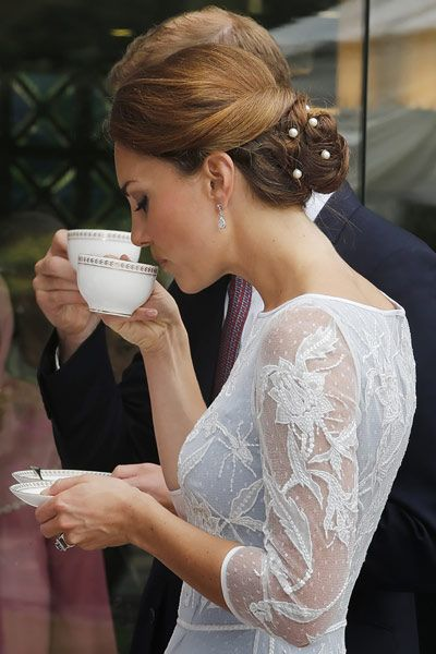 Looking sweet and sophisticated for the Diamond Jubilee Tea Party at the British High Commission in Kuala Lumpar, Malaysia.    The Duchess of Cambridge matched her embroidered Alice Temperley dress with a traditional Malaysian hairstyle. With pearls intricately woven into her delicate chignon Kate showed that she could combine politics with style