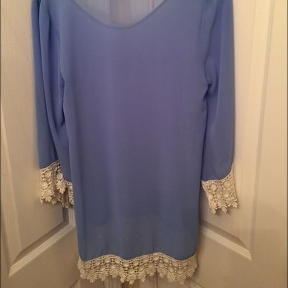 Sheer blue tunic/swim cover up medium Worn a few times. Looks new. No signs of wear Dresses