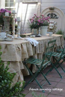I'm in love! a ruffled burlap tablecloth!